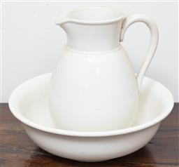 Sale 9120H - Lot 365 - A ceramic wash jug and basin in off white. Height of jug 26cm