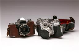 Sale 9119 - Lot 507 - Two Vintage Cameras: Praktica IV FB & Zeiss Ikon Contarex in Leather Cases