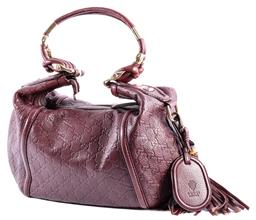 Sale 9132 - Lot 407 - A GUCCI BURGUNDY EMBOSSED LEATHER MONOGRAM HOBO BAG; zip top closure with gold tone hardware, double rolled handles, luggage tag and...
