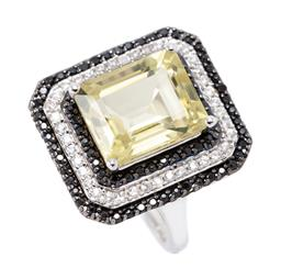 Sale 9177 - Lot 323 - A SILVER CITRINE AND STONE SET COCKTAIL RING; featuring an emerald cut citrine of approx. 6ct to surround of black and white round c...
