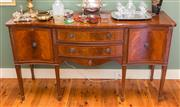 Sale 8270 - Lot 93 - An English flame mahogany Vintage serpentine front sideboard. The shaped top edge cross banded and strung. The bowed centre with two...