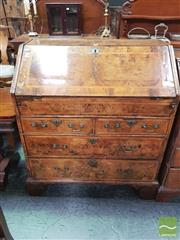Sale 8444 - Lot 1076 - Early Georgian Walnut Bureau, the facings with crossbanding and herringbone bands, enclosing a fitted interior with pigeon-holes, dr...