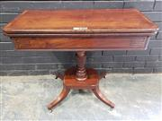 Sale 9014 - Lot 1074 - Regency Mahogany Tea Table, with hinged demi-lune top, geometric ebony string-inlay, on a turned pedestal with pineapple knop, on a...