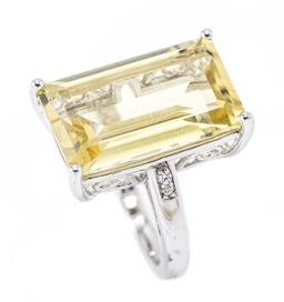 Sale 9177 - Lot 302 - A SILVER GEMSET COCKTAIL RING; featuring a step cut lemon quartz of approx. 12ct to shoulders set with 4 zirconias, top 21 x 14mm, s...