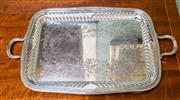 Sale 8270 - Lot 96 - An English silverplate double handle tray, the centre hand engraved with trailing foliage, framed by a wide half fluted border. C: 1...