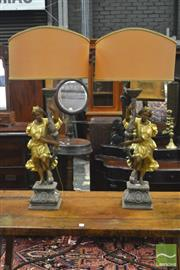 Sale 8359 - Lot 1033 - Pair of Good Italian Baroque Style Carved & Gilt Gesso Table Lamps, of contrapposto figures supporting torches with candle fittings,...