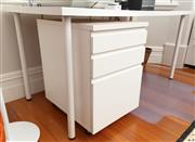 Sale 8863H - Lot 54 - An Ikea white table with tubular legs, Height 74cm, Width 150cm, Depth 75cm, together with a similar three drawer cabinet