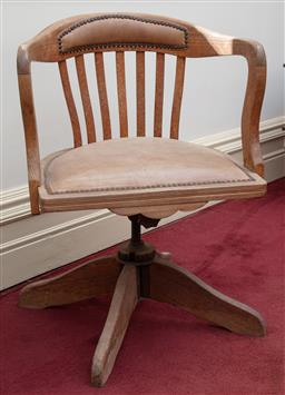 Sale 9190H - Lot 289 - An Edwardian antique pine Desk chair C: 1905. The tub shaped staved back and seat in studded parchment leatheronto the metal swivle ...