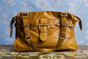 Sale 8577 - Lot 24 - A Country Road tan leather handbag featuring brushed gold hardware, front pocket & brown lining - Condition: Very Good - measurement...