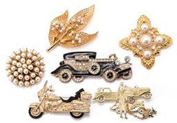 Sale 9164J - Lot 518 - SIX COSTUME TRANSPORT AND FAUX PEARL BROOCHES, all in gold tone metal fashioned as a vintage Rolls Royce with black enamel and cryst...