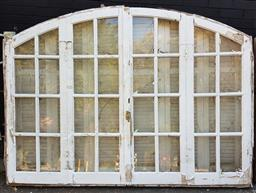 Sale 9174 - Lot 1472 - Arched timber framed window with shutters - some losses to glass panels (h167 x w234cm)