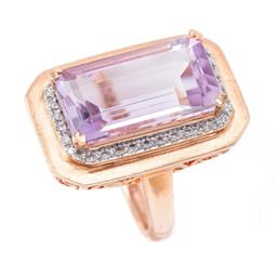 Sale 9177 - Lot 399 - A SILVER AMETHYST COCKTAIL RING; set in a rose plated silver, centring an emerald cut amethyst of approx. 9.88ct to a surround of 32...