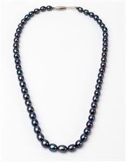 Sale 8550F - Lot 263 - A string necklace of blue cultured freshwater pearls and sterling silver clasp, L 40cm.