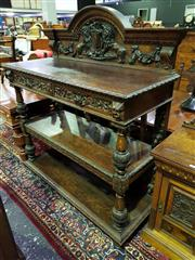 Sale 8653 - Lot 1008 - Impressive Victorian Carved Oak Dumbwaiter, the back carved with a crest supported by rampant lions, above two frieze drawers & two...