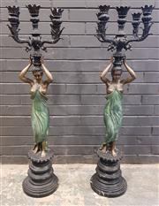 Sale 9014 - Lot 1002 - Pair of Cast Metal & Patinated Floor Candelabra, of scantily clad women, holding each aloft five branches & raise don turned pedesta...