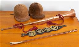 Sale 9103M - Lot 756 - A group of horse related items including English made velvet riding helmets, copper and brass hunting horn, and brass mounted horse...