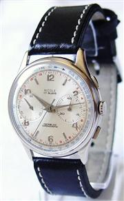 Sale 8362A - Lot 34 - A large Mens circa 1940s chronograph wristwatch by Nicole, Swiss made, Landeron complicated movement mechanical wind, 38 mm with...
