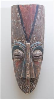 Sale 8550H - Lot 212 - An antique timber South East Pacific island mask with red, black, white and green decoration, H 46 x D 14cm