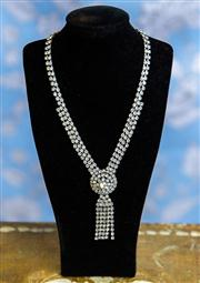 Sale 8577 - Lot 26 - A vintage Art Deco style diamante necklace featuring round raised centre piece with 5 single diamante strands - Condition: Very Good...