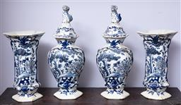 Sale 9120H - Lot 371 - A garniture of four continental faience blue and white vases in the chinese taste, tallest 37cm. Bears Vintage James R Lawsons lot s...
