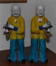 Sale 7981B - Lot 26 - PAIR OF CHINESE FAMILLE JUANE 'LAUGHING BOYS' FIGURES, QING DYNASTY  each well modelled standing holding a basket of auspicious fr...