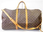 Sale 8362A - Lot 35 - A vintage French Louis Vuitton Keepall travel bag with shoulder strap, 60 cm
