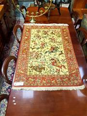 Sale 8693 - Lot 1063 - Signed Qum Silk Hunting Carpet, with equestrian figures & wild animals 144 x 98 cm (with certificate)