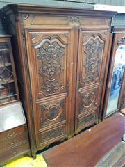 Sale 8795 - Lot 1013 - French Renaissance Style Carved Walnut Armoire, with two multi-panelled doors with masks, strap and foliate work, on cabriole legs....