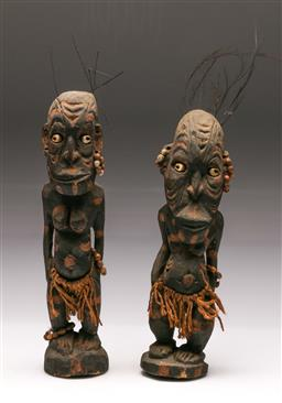 Sale 9119 - Lot 155 - A pair of carved cultural figures (H: 30cm) (some losses)