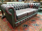 Sale 8576 - Lot 1007 - Buttoned Burgundy Leather Three Seater Chesterfield, with stud detail & buttoned front rail