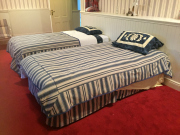 Sale 8677B - Lot 847 - Two single beds, with blue striped upholstery