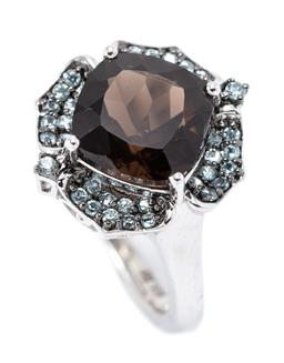 Sale 9177 - Lot 307 - A SILVER STONE SET RING; flower shaped top centring a cushion cut smoky quartz to petal surround of pale blue topaz, top 16.5 x 15.5...