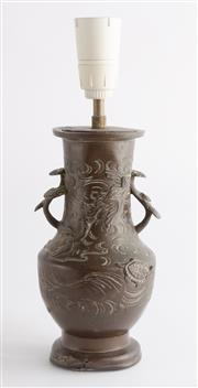 Sale 8536 - Lot 70 - An antique Chinese bronze urn or vase decorated with a land and sea theme. The twin handles with applied mushroom clouds, converted...