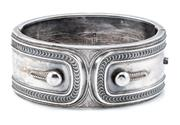Sale 8915 - Lot 354 - A VICTORIAN STERLING SILVER HINGED CUFF BANGLE; 3cm wide with applied cuff and link design, hallmarked Birmingham 1882, internal cir...