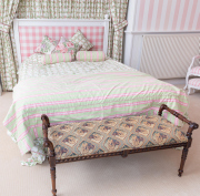 Sale 8677B - Lot 848 - A double bed with pink gingham upholstered headboard