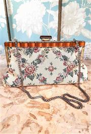 Sale 8577 - Lot 32 - A 1950s vintage floral tapestry clutch purse with decorative amber lucite frame/ clasp, gold accents and goldtone link chain, W 29...