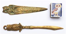 Sale 9144 - Lot 439 - Two brass Owl letter openers together with an owl matchbox cover