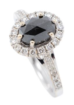 Sale 9168J - Lot 377 - AN 18CT WHITE GOLD BLACK AND WHITE DIAMOND RING; centring a 7 x 5mm oval rose cut black diamond to surround and shoulders set with 3...