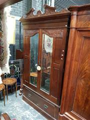 Sale 8925 - Lot 1006 - A carved and mirror panelled wardrobe with carved pediment and drawer to base