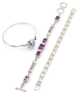 Sale 9145 - Lot 322 - THREE SILVER BRACELETS; 9mm wide set with 5 emerald cut amethysts to double foxtail links and toggle clasp, adjustable length 18-20c...