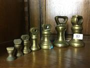 Sale 8730B - Lot 83 - Set of Brass Scale Weights for Gold Scales (7) height of tallest: 9cm