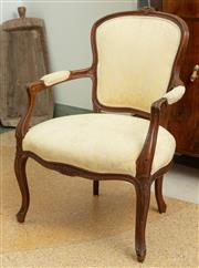 Sale 9066H - Lot 44 - A pair of Louis XV style bergeres with an acanthus seat back and elbow pad (staining). Height of back 89cm.