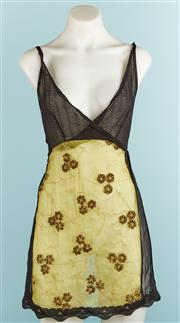 Sale 9071F - Lot 52 - A MAZI SLIP TOP; in black lace with embroided flowers & open back, size S