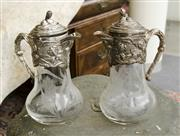 Sale 8205 - Lot 98 - A pair of etched glass claret jugs with EP tops, one damaged, H 28cm