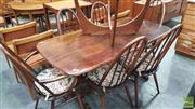 Sale 8383 - Lot 1033 - Ercol Elm Table and Set of Six Chairs
