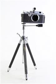 Sale 8852 - Lot 68 - A Cannon Camera (a.f) Together with Small Tripod and Slide