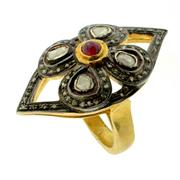 Sale 8060B - Lot 368 - A SILVER GILT RUBY AND DIAMOND RING; oxidised top set with a cabochon ruby surrounded by table, single and flat cut diamonds. Size O.