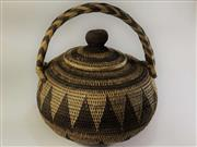 Sale 8600A - Lot 61 - A Papua New Guinean woven basket, H 30 x W 28cm.