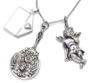 Sale 8974 - Lot 318 - THREE VICTORIAN STYLE SILVER PENDANTS ON CHAIN; envelope, cherub, and a miniature hand mirror adorned with nouveau lady, 3.5-5.5cm l...