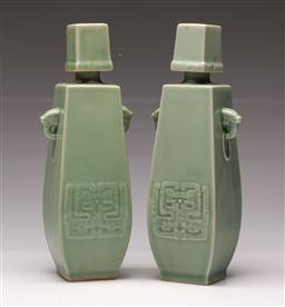 Sale 9119 - Lot 157 - A pair of green glazed ceramic decanters (H 26cm)